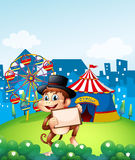 A monkey holding a frame in front of the carnival Royalty Free Stock Photography