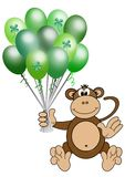 Monkey holding St. Patrick's day balloons Royalty Free Stock Images
