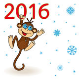 Monkey holds for the inscription 2016 and hangs on it Royalty Free Stock Images