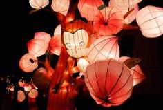 Monkey lantern in the peach trees Royalty Free Stock Photos