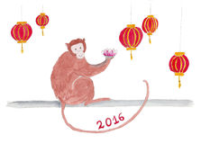 Monkey with lanterns and a lotus flower. Stock Photos