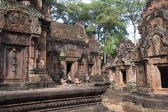 Monkey and lion guardians sitting at entrances of the sanctuary at the 10th century Banteay Srei temple Stock Photography