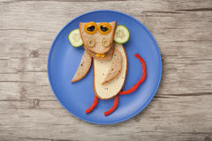 Monkey made of bread, cheese and vegetables Royalty Free Stock Images