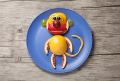 Monkey made of juicy fruits Stock Image