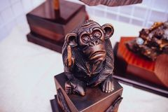 Monkey made by wood making screw sign. With middle finger, as a joke Royalty Free Stock Images