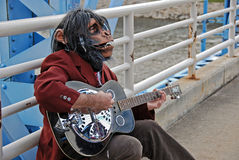 Monkey Man playing guitar Royalty Free Stock Photography