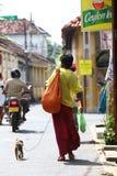 Monkey man. Man walking with his monkey trying to do business in Dhaka Bangladesh Stock Image