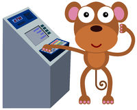 Monkey with money machine Stock Photos