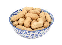 Monkey nuts in a blue and white china bowl Royalty Free Stock Image