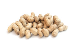 Monkey nuts, peanuts or groundnuts in shells, isolated on a whit. E background Royalty Free Stock Image