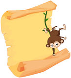 A monkey and a paper sheet Stock Photography
