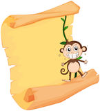A monkey and a paper sheet Stock Images