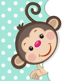 Monkey peeking out Stock Photo
