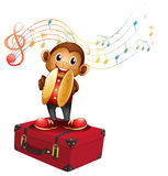 A monkey playing cymbals above an attache case Royalty Free Stock Photo