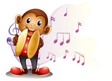 A monkey playing with the cymbals Stock Photography