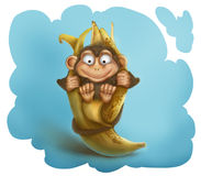 Monkey plays with a banana Stock Photography