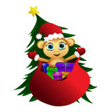 Monkey popping up from the bag of gifts . Stock Photos