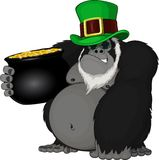 Monkey with a pot of gold Stock Photo