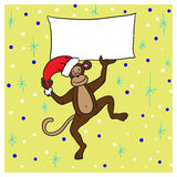 Monkey in a red cap holding a poster with congratulations happy. Brown monkey in a red cap holding a poster with congratulations happy new year 2016 Royalty Free Stock Photos