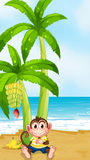 A monkey resting under the banana plant at the beach Royalty Free Stock Images