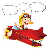 A monkey riding on a red plane Stock Photos