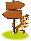 A monkey running beside the empty arrowboards Royalty Free Stock Photography
