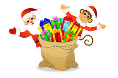 Monkey and Santa Claus with a bag of gifts Royalty Free Stock Photography