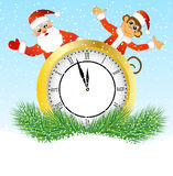 Monkey Santa Claus peeking out of the clock Stock Photo