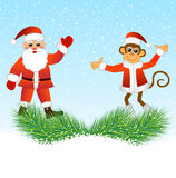 Monkey and Santa Claus standing on the branches of spruce Stock Photo