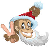 Monkey in Santa hat showing two fingers - gesture victory. Symbol 2016. Royalty Free Stock Photography