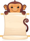 Monkey with scroll Stock Image