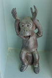 Monkey sculpture with smiling face. And rise hand up Royalty Free Stock Photography