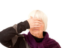 Monkey see - Old lady holding hand over eyes Royalty Free Stock Photos