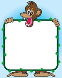 Monkey with Sign. Cheerful monkey holding blank sign with leafy border Stock Photo