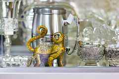 Monkey and silver utensil with patterns. Royalty Free Stock Images