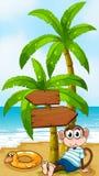 A monkey sitting below the wooden arrowboard Stock Photos