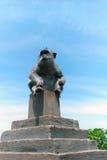 Monkey sitting on a pedestal. Chinese 2016 New Year symbol Royalty Free Stock Image