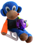Monkey on a sledge. With Christmas balls Royalty Free Stock Photography