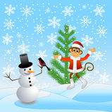 Monkey and snowman in the forest Royalty Free Stock Photo