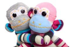 Monkey sock toy isolated on white Stock Image