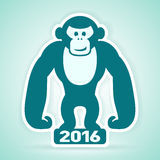 Monkey stands on New Year 2016 Stock Photography