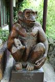 Monkey. Statue carved from wood surface modified stock images