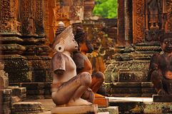Monkey statues in front of temple. Banteay Srei temple, Angkor, Cambodia stock photography
