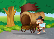 A monkey at the street standing beside the wagon with an empty s Stock Images