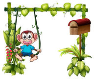 A monkey swinging beside a wooden mailbox Royalty Free Stock Images