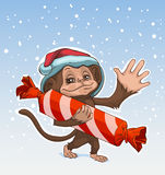Monkey symbol 2016. Monkey has great candy. Monkey in Santa hats Greeting Royalty Free Stock Images