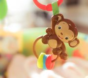 Baby toy. Monkey toy with colorful blurred background in a child`s playroom Royalty Free Stock Images
