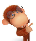The monkey wearing spectacles reads Stock Images