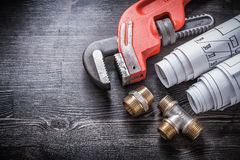 Monkey wrench brass plumbing fittings rolled Royalty Free Stock Image
