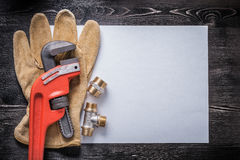 Monkey wrench copper pipe fittings leather Stock Photos